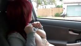 Cute looking red head riding her car and rubbing her sweet pussy hole