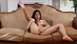 Sassy sinful young chick gets busted jerking her pussy off