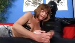 Depraved milf fondles a member of an unknown man in latex suit